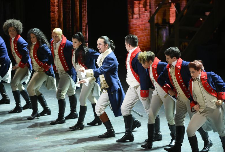 """Lin-Manuel Miranda, center, and the cast of """"Hamilton"""" perform at the Tony Awards at the Beacon Theatre on Sunday, June 12, 2016, in New York. (Photo by Evan Agostini/Invision/AP)"""