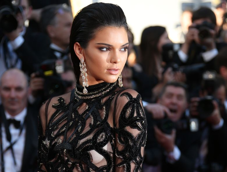 """FILE – In this May 15, 2016, file photo, Kendall Jenner poses for photographers upon arrival at the screening of the film Mal De Pierres at the Cannes International Film Festival in southern France. Fashion designer shared a photo on Facebook June 22, 2016, of an advertisement featuring Jenner made up as what Jacobs calls a """"goth goddess."""" (AP Photo/Joel Ryan, File)"""