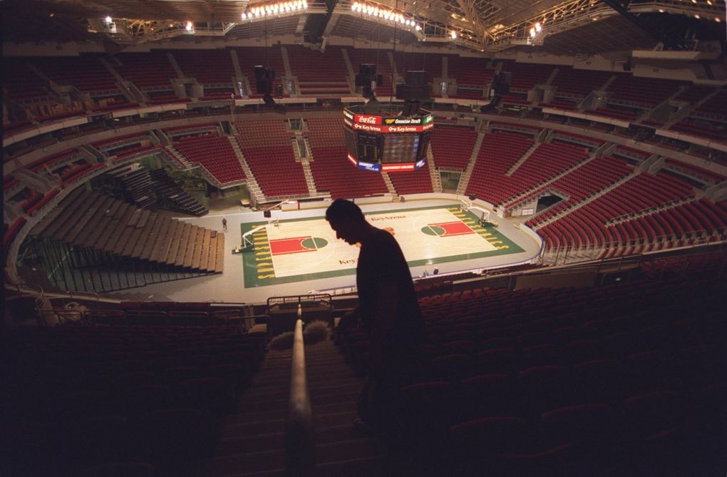 A worker dusts in the upper level of the renovated KeyArena in 1995. (Mike Siegel / The Seattle Times)