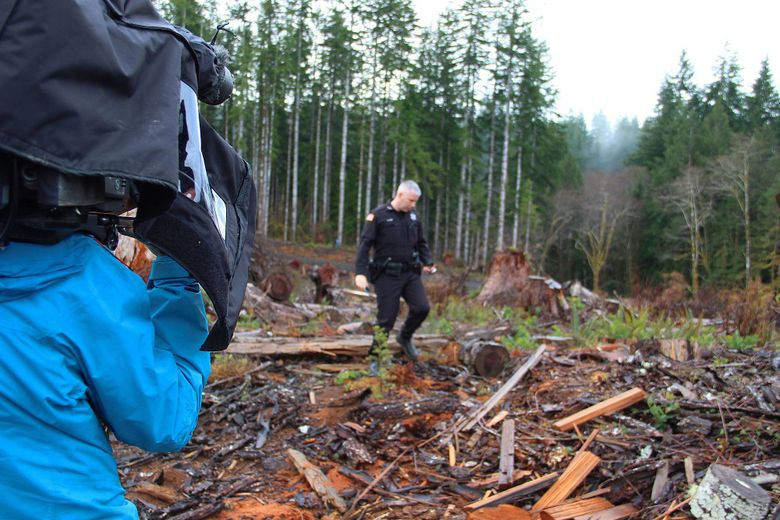 """Grays Harbor County sheriff's Deputy Sean Gow is filmed as he investigates a cedar-theft site in an upcoming episode of the Discovery Channel's """"Dark Woods Justice."""" (Discovery Channel)"""