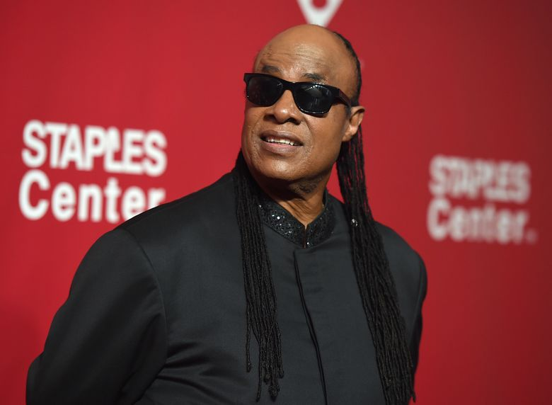 FILE – In this Feb. 13, 2016 file photo, Stevie Wonder arrives at the MusiCares Person of the Year tribute honoring Lionel Richie in Los Angeles. BET announced Thursday, June 23, that Wonder will join Sheila E., D'Angelo, The Roots and Janelle Monae to honor Prince at the Microsoft Theater in Los Angeles. (Photo by Jordan Strauss/Invision/AP, File)