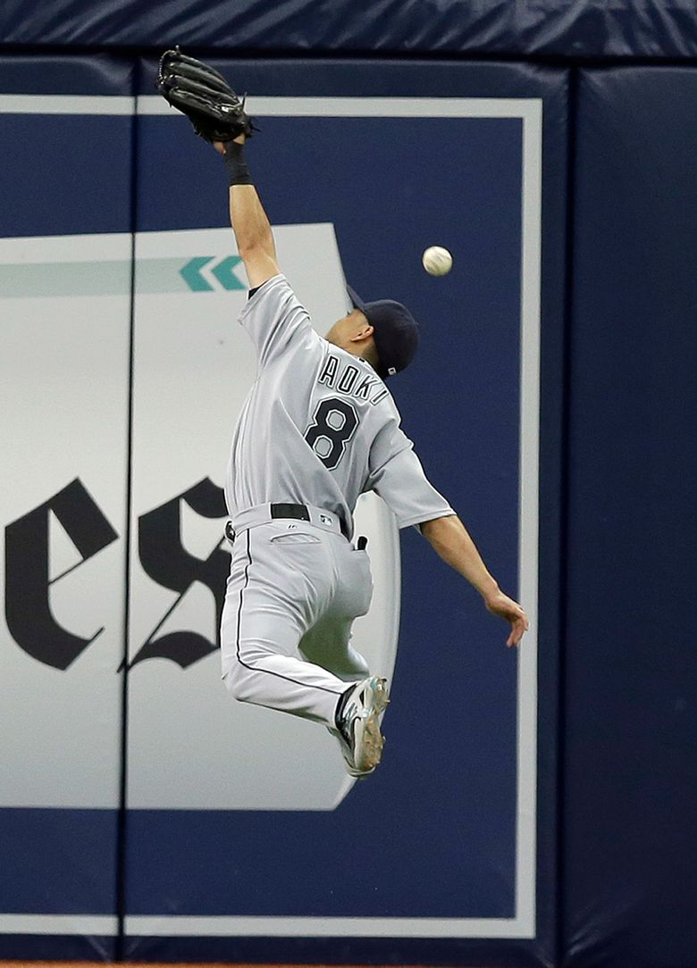 Seattle Mariners left fielder Norichika Aoki, of Japan, is struggling at the plate, which has earned him a demotion from leadoff to the bottom of the order.  (Chris O'Meara/AP)