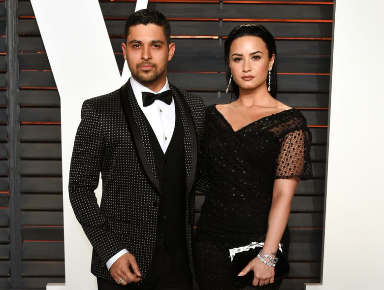 FILE – In this Feb. 28, 2016, file photo, Wilmer Valderrama, left, and Demi Lovato arrive at the Vanity Fair Oscar Party in Beverly Hills, Calif. Lovato and Valderrama have announced Friday, June 3 on their social media accounts, that they're ending their relationship after nearly six years together. (Photo by Evan Agostini/Invision/AP, File)