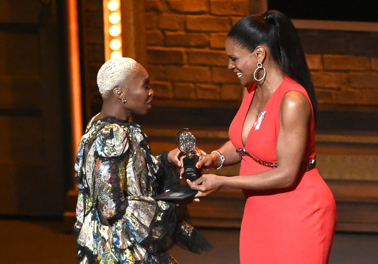 """Cynthia Erivo, left, accepts the award for leading actress in a musical for """"The Color Purple"""" from presenter Audra McDonald at the Tony Awards at the Beacon Theatre on Sunday, June 12, 2016, in New York. (Photo by Evan Agostini/Invision/AP)"""
