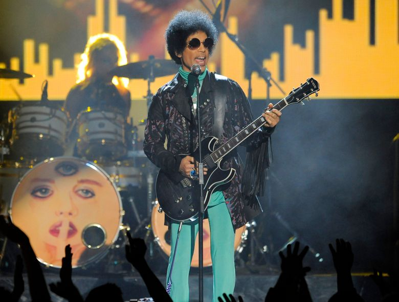 FILE – In this May 19, 2013 file photo, Prince performs at the Billboard Music Awards at the MGM Grand Garden Arena in Las Vegas. A law-enforcement official says that tests show the music superstar died of an opioid overdose. Prince was found dead at his home on April 21, 2016, in suburban Minneapolis. He was 57.  (Photo by Chris Pizzello/Invision/AP, File)