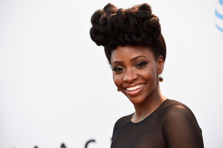 FILE – In this Feb. 5, 2016 photo, Teyonah Parris arrives at the 47th NAACP Image Awards at the Pasadena Civic Auditorium in Pasadena, Calif.  Parris follows up 'Chiraq' with another challenging role, playing R&B songstress Miki Howard for TV One's first biopic. (Photo by Chris Pizzello/Invision/AP)