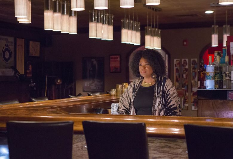 """This image released by OWN shows Oprah Winfrey as Mavis McCready in a scene from the original series, """"Greenleaf."""" The show, which premieres Tuesday at 10 p.m.,  explores the flawed nature of the first family of a sprawling Memphis, Tennessee, megachurch.  Winfrey, who is the executive producer, plays an outspoken bar owner she calls the """"high priestess"""" of the neighborhood. (OWN via AP)"""