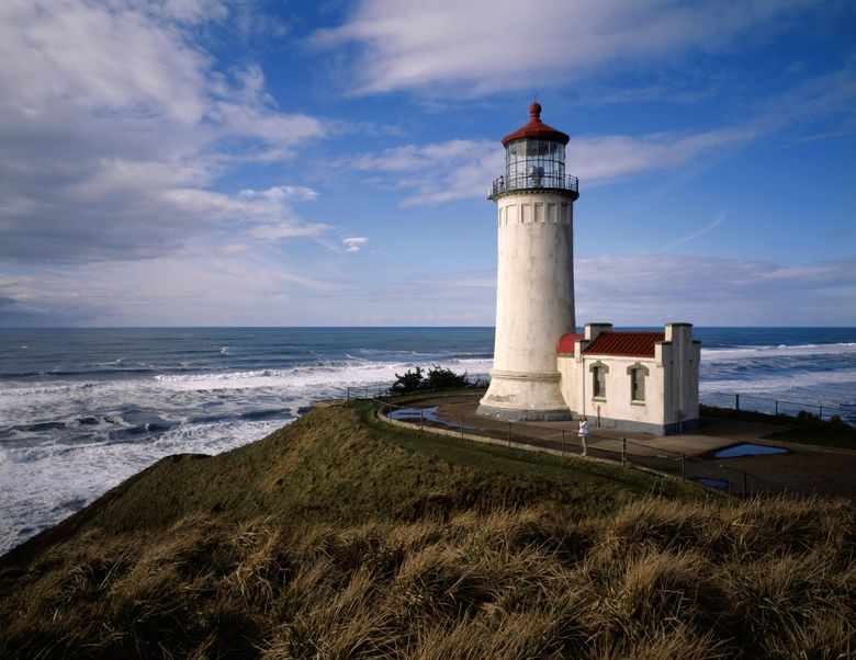 North Head Lighthouse, at Cape Disappointment State Park in Ilwaco, is among state parks waiving entry fees Saturday. (Benjamin Benschneider / The Seattle Times)