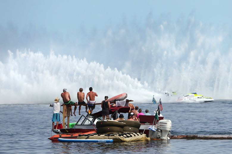 Spectators with a boat-side view watch the H1 Unlimited Hydroplane Heat 2A during the last day of Seafair and the Albert Lee Appliance Cup H1 Unlimited Fleet on Lake Washington in Seattle, Sunday, Aug. 2, 2015. (Sy Bean / The Seattle Times)