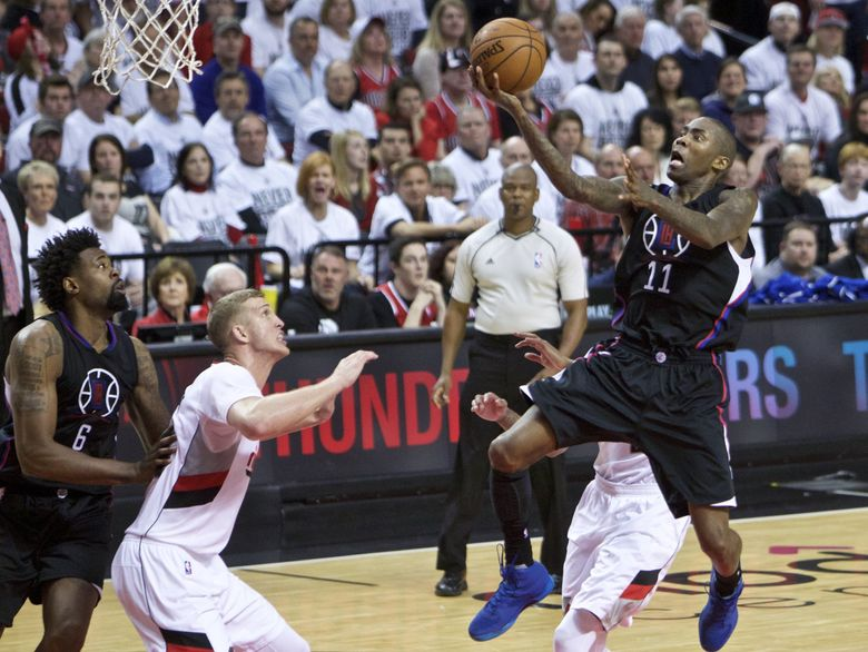 Los Angeles Clippers guard Jamal Crawford, right, shoots over Portland Trail Blazers center Mason Plumlee, second from left, during the second half of Game 6 of an NBA basketball first-round playoff series Friday, April 29, 2016, in Portland, Ore. The Trail Blazers won 106-103. (Craig Mitchelldyer / AP)
