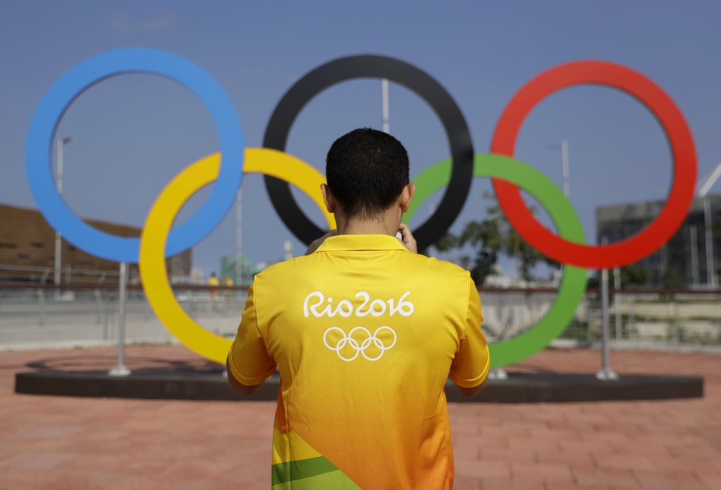 A volunteer photographs a set of Olympic Rings at Olympic Park in Rio de Janeiro, Brazil, July 29. (Patrick Semansky / AP)