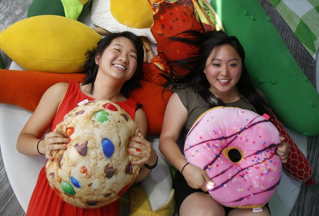 It's OK to play with some of your food at the Bite of Seattle. Jane Park, left, and Paulette King have fun with a plate of fake food at last year's three-day food fest at Seattle Center. (Sy Bean / The Seattle Times)