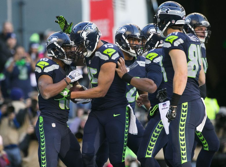 Seahawks wide receiver Tyler Lockett celebrates a touchdown with Seahawks wide receiver Jermaine Kearse and the rest of the team in the second quarter as the Seattle Seahawks take on the San Francisco 49ers at CenturyLink Field in Seattle Sunday November 22, 2015. (Bettina Hansen/The Seattle Times)