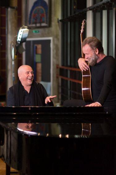 Peter Gabriel, left, and Sting perform together at KeyArena on Thursday, July 21.