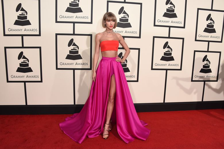 FILE – In this Feb. 15, 2016, file photo, Taylor Swift arrives at the 58th annual Grammy Awards at the Staples Center in Los Angeles. Swift's recent spat with Kanye West, coming days after Calvin Harris lashed out at his ex-girlfriend on Twitter, has people taking sides and throwing shade at music industry's Grammy-winning good girl. (Photo by Jordan Strauss/Invision/AP, File)