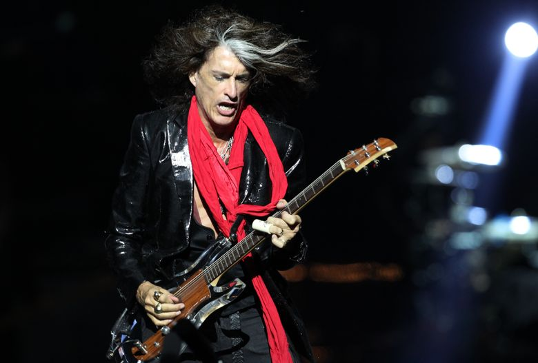 FILE – In this Saturday, May 25, 2013 file photo, lead guitarist Joe Perry, of American rock band Aerosmith, performs in Singapore during the inaugural Social Star Awards concert. Aerosmith co-founder and guitarist Perry has been taken to a hospital after he was forced to leave the stage while performing in New York City. Perry became ill on Sunday. July 11, 2016, while performing with Johnny Depp and Alice Cooper in his side band, the Hollywood Vampires, at Ford Amphitheater at the Coney Island boardwalk in Brooklyn. (AP Photo/Wong Maye-E, File)