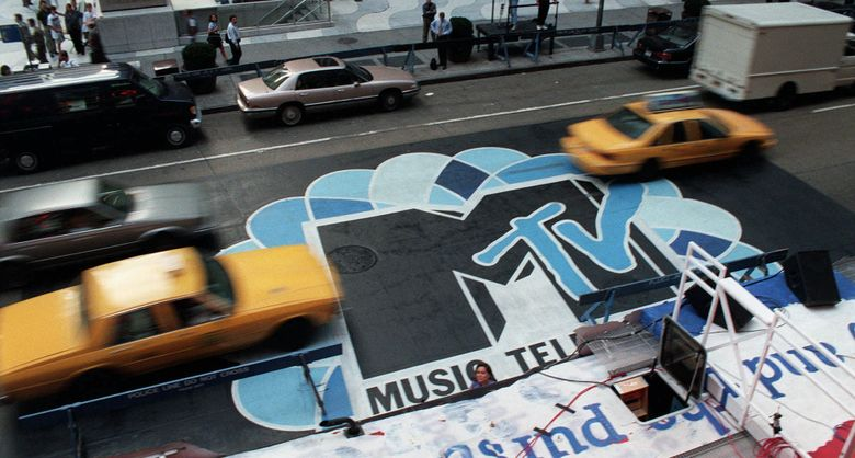 FILE — In this Sept. 3, 1996, file photo, traffic moves along 6th Avenue in New York, over the logo painted in the street outside Radio City Music Hall for the MTV Music Video Awards ceremony. MTV announced July 28, 2016, that it is rebranding VH1 Classic as MTV Classic and the channel will focus on 1990s and early 2000s nostalgia. (AP Photo/Todd Plitt, File)