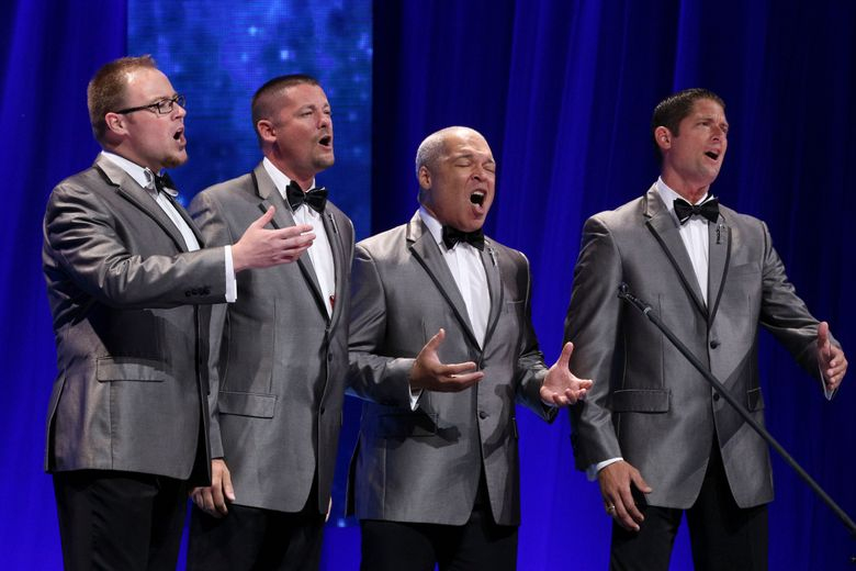 This July 9, 2016 image released by Barbershop Harmony Society shows, members of the barbershop quartet Forefront, from left, Drew Wheaton, Kevin Hughes, Brian O'Dell and Aaron Hughes, during a competition at the Bridgestone Arena in Nashville, Tenn. The group took home the Barbershop World Quartet gold medal. ( Lorin May/Barbershop Harmony Society via AP)