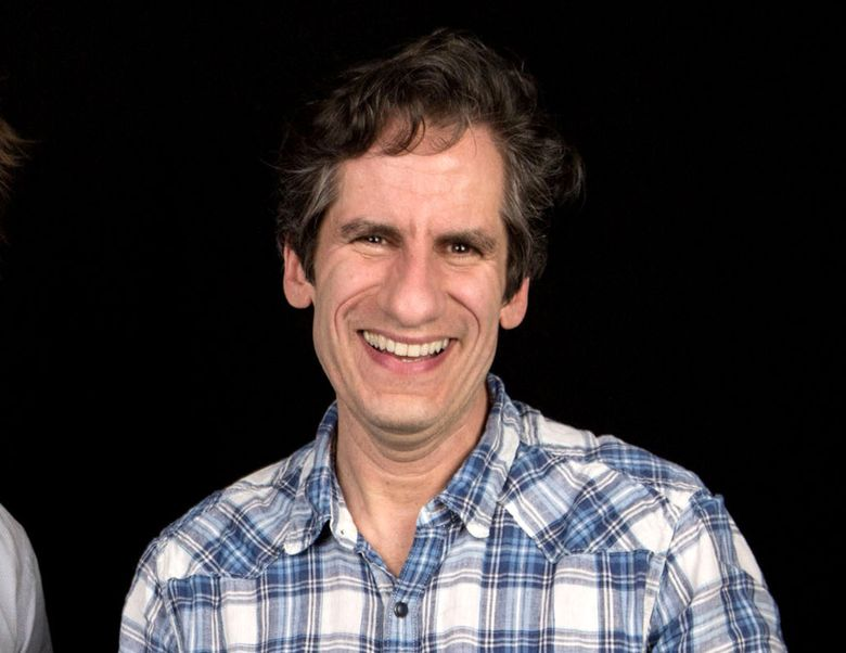 """FILE – In this April 1, 2016 file photo,  Seth Rudetsky poses after an interview in New York. Rudetsky and his husband, producer James Wesley enlisted a group of Broadway veterans including Audra McDonald and Idina Menzel to record a new version of the iconic 1965 song """"What the World Needs Now is Love,"""" with all proceeds going to help the LGBT Center of Central Florida. (Photo by Amy Sussman/Invision/AP, File)"""