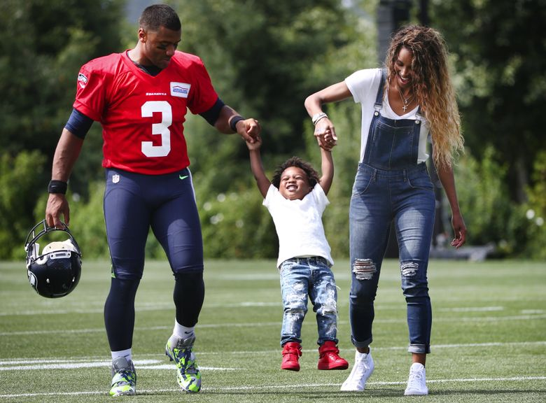 Seahawks quarterback Russell Wilson and wife Ciara pick up Ciara's son, Future Zahir, after practice on the first day of Seahawks training camp in 2016. Both will be investors in a group hoping to bring Major League Baseball to Portland.  (Lindsey Wasson/The Seattle Times)