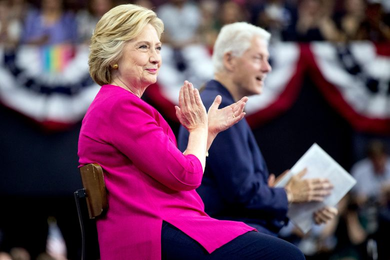 Democratic presidential candidate Hillary Clinton and former President Bill Clinton arrive for a rally at McGonigle Hall at Temple University in Philadelphia, Friday, July 29, 2016. Clinton and Kaine will begin a three day bus tour through the rust belt. (AP Photo/Andrew Harnik)