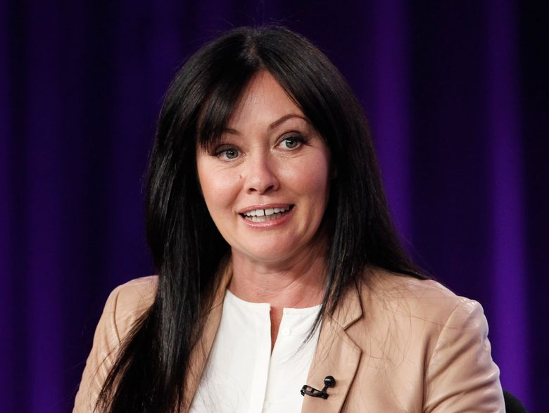 """FILE – In this Jan. 14, 2012, file photo, Shannen Doherty participates in a panel for the television show """"Shannen Says"""" on WE tv during the AMC Networks portion of the Television Critics Association Winter Press Tour in Pasadena, Calif. Doherty posted pictures on Instagram Tuesday, July 19, 2016, shaving off her hair. It was revealed that Doherty had breast cancer in August 2015. (AP Photo/Danny Moloshok, File)"""