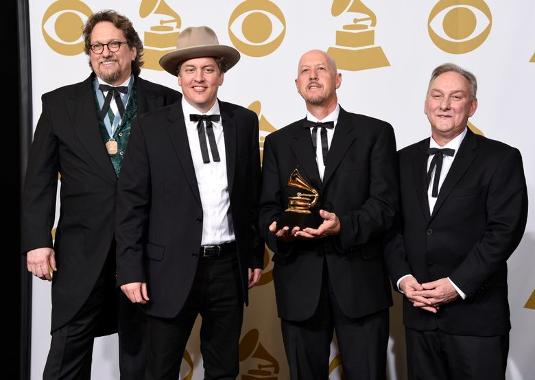 """FILE – In this Feb. 8, 2015 file photo, Jerry Douglas, from left, Shawn Camp, John Warren and Charlie Cushman, of The Earls Of Leicester, pose in the press room with the award for best bluegrass album for """"The Earls Of Leicester"""" at the 57th annual Grammy Awards in Los Angeles. The band os nominated for eight awards individually and as a group, including entertainers of the year, at this year's International Bluegrass Music Awards. The awards show will be held on September 29 in Raleigh, N.C. (Photo by Chris Pizzello/Invision/AP, File)"""