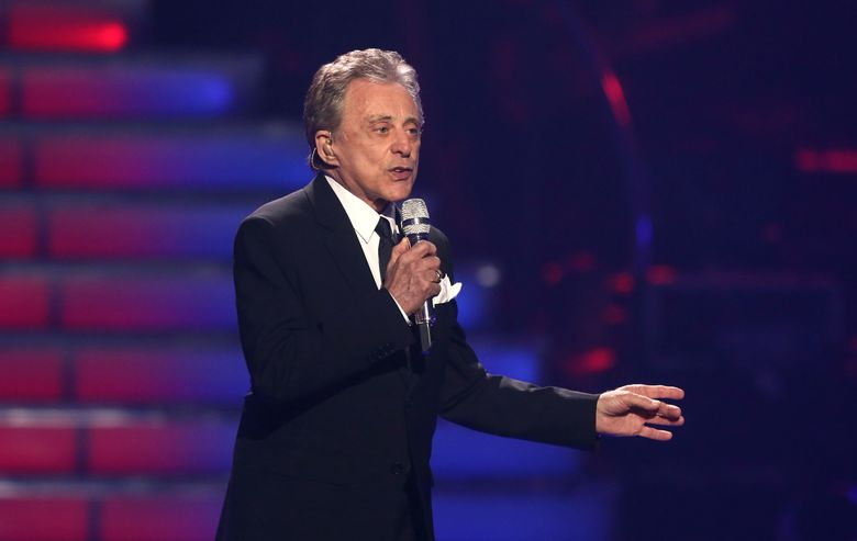 """FILE – In this May 16, 2013 file photo, Frankie Valli performs at the """"American Idol"""" finale at the Nokia Theatre at L.A. Live in Los Angeles. Valli, whose falsetto fuels The Four Seasons' music, will return to Broadway for seven shows from Oct. 21-29 at the Lunt-Fontanne Theatre. (Photo by Matt Sayles/Invision/AP, File)"""