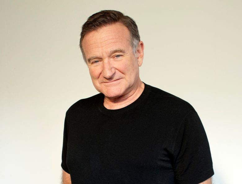 """FILE – In this Nov. 5, 2011 file photo, actor Robin Williams poses for a portrait during the """"Happy Feet"""" press junket in Beverly Hills, Calif. Arthur Grace, a photographer and friend of the late Robin Williams, is publishing a book with 190 of his photographs of the late actor-comedian. It will be released next month. (Dan Steinberg/Invision/AP, File)"""