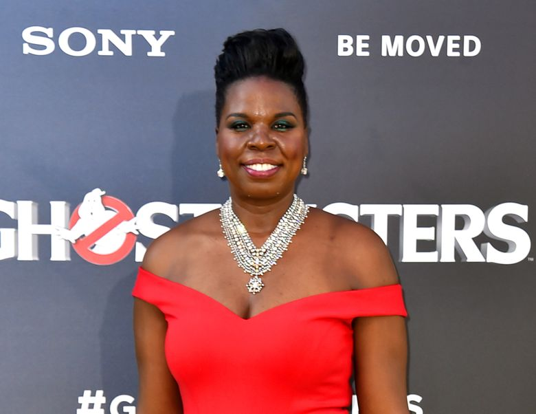 """FILE – In this July 9, 2016 file photo, Leslie Jones arrives at the Los Angeles premiere of """"Ghostbusters."""" In a series of posts Monday, July 19, Jones said she had been pummeled with racist tweets. She said the messages were deeply hurtful and brought her to tears. (Photo by Jordan Strauss/Invision/AP, File)"""