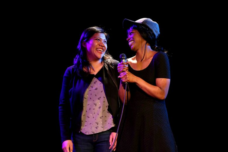 """Actors Julie Hoang, left, and Kamaria Hallums-Harris take a turn in a """"Spin the Bottle"""" night at Annex Theatre."""