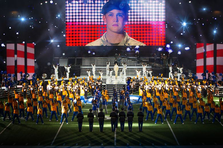"""This image released by Sony Pictures shows Joe Alwyn, portraying Billy Lynn, on a screen in a scene from the film, """"Billy Lynn's Long Halftime Walk."""" The film, by Ang Lee, will premiere at the New York Film Festival on Oct. 14. (Mary Cybulski/Sony-TriStar Pictures via AP)"""