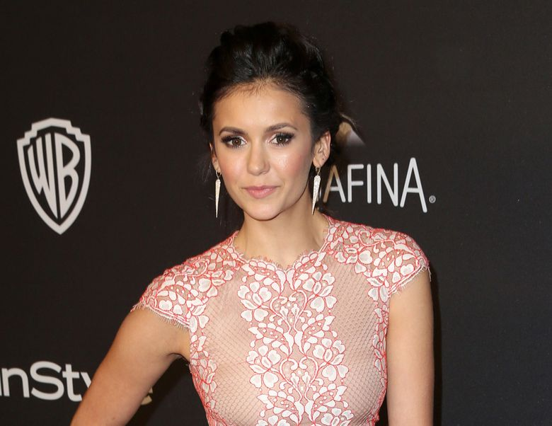 """FILE – In this Jan. 10, 2016 file photo, Nina Dobrev arrives at the InStyle and Warner Bros. Golden Globes afterparty in Beverly Hills, Calif. The CW president, Mark Pedowitz, says the network is in talks with Nina Dobrev about returning for """"The Vampire Diaries"""" series finale. It was announced in July that the series would end after its upcoming eighth season. (Photo by Matt Sayles/Invision/AP, File)"""