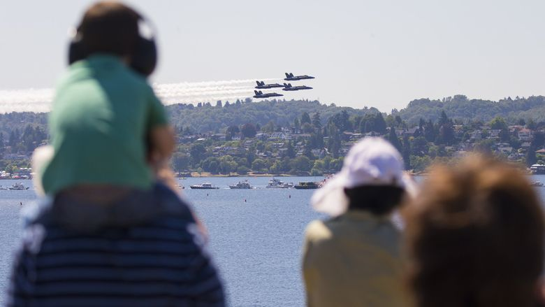 The Blue Angels fly over Lake Washington during practice on Thursday. (Mike Siegel / The Seattle Times)