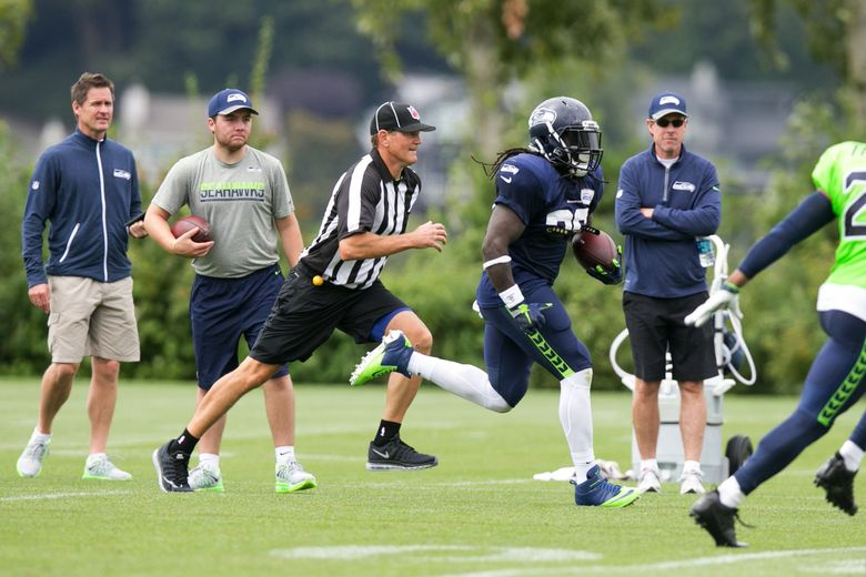Running back Alex Collins scores a touchdown during a scrimmage game at Seattle Seahawks training camp. (Bettina Hansen / The Seattle Times)