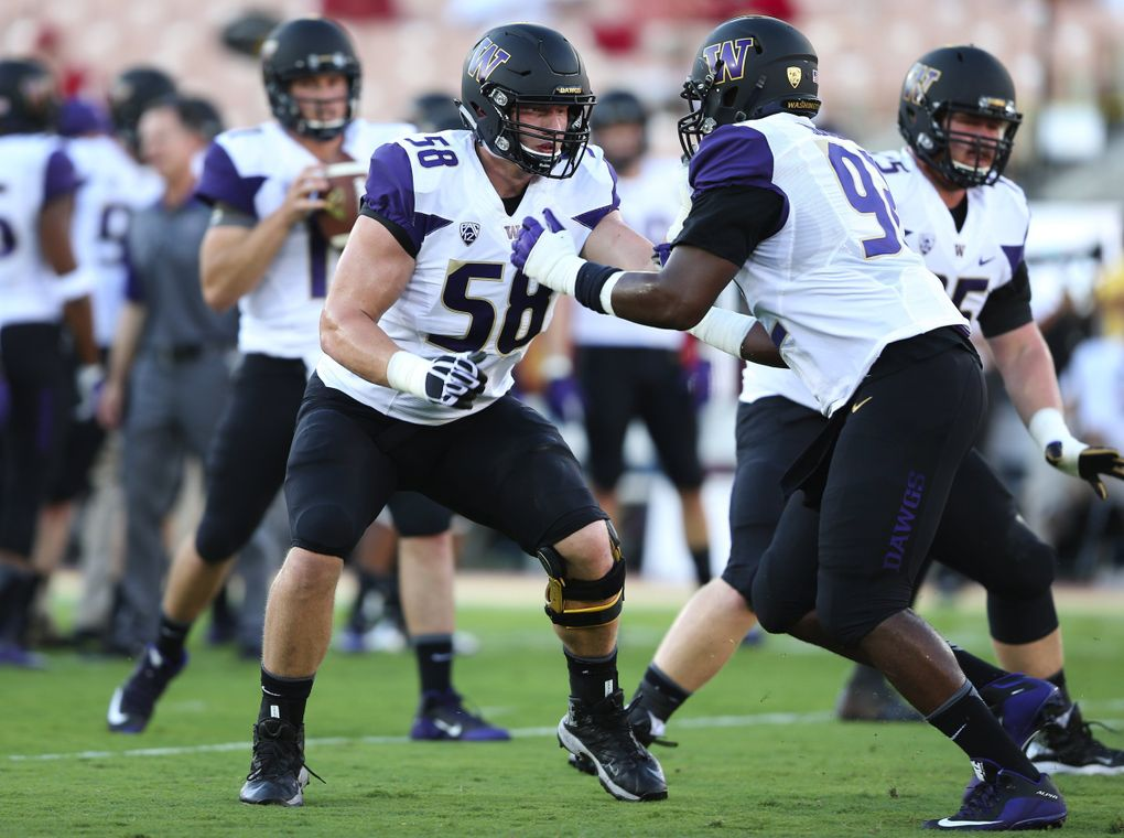 Washington offensive lineman Kaleb McGary, left, practices with Washington defensive lineman Jaylen Johnson before the Washington vs. Southern California game in Los Angeles at Memorial Coliseum on Thursday, Oct. 8, 2015. Washington beat Southern California 17-12, beating former coach Steve Sarkisian in their first meeting since his abrupt departure for the head coaching job at USC in late 2013.   (Lindsey Wasson / The Seattle Times)