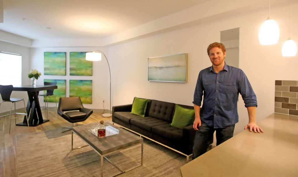 Matt Calkins in his redesigned apartment by Seahawks rookie Zac Brooks. (Greg Gilbert / The Seattle Times)
