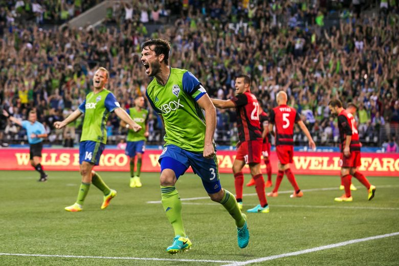 Sounders defender Brad Evans celebrates a goal he assisted on, headed in by Cristian Roldan in the second half as the Seattle Sounders take on the Portland Timbers at CenturyLinkField in Seattle Sunday August 21, 2016.  (Bettina Hansen / The Seattle Times)