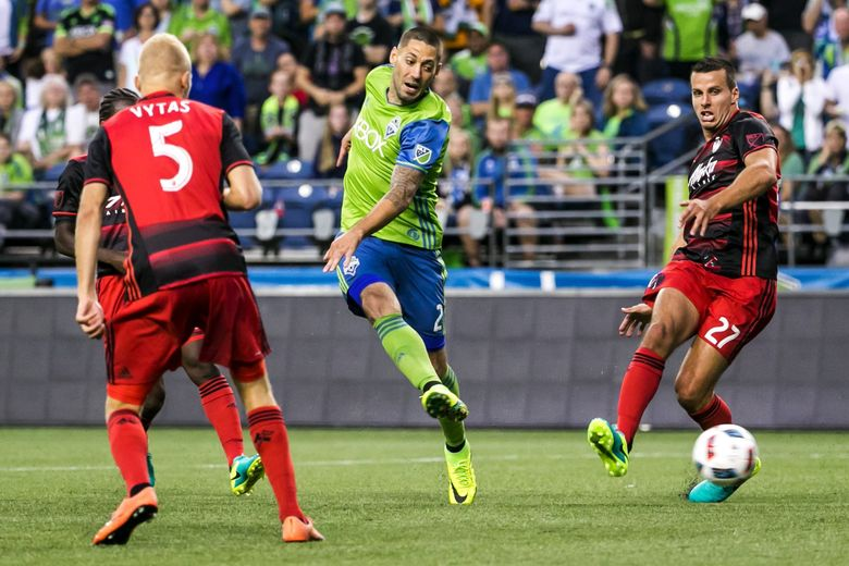 Sounders forward Clint Dempsey takes a shot on goal last August in what was his final game before being diagnosed with an irregular heartbeat.  (Bettina Hansen / The Seattle Times)