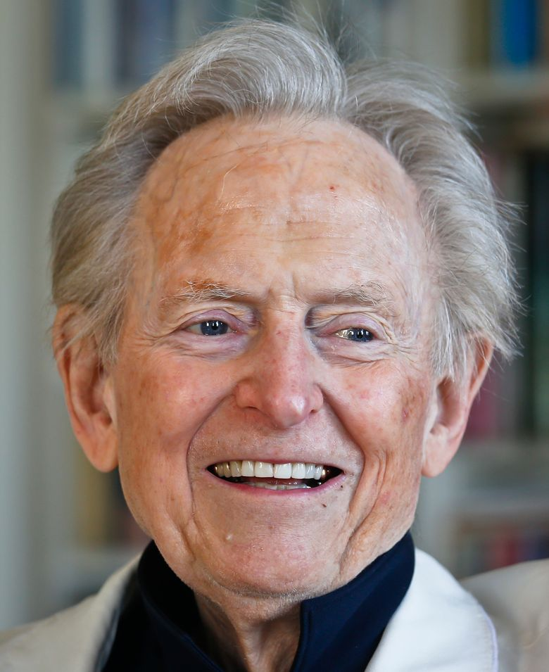 """In this July 26, 2016 photo, American author and journalist Tom Wolfe, Jr. appears in his living room during an interview about his latest book, """"The Kingdom of Speech,"""" in New York. (AP Photo/Bebeto Matthews)"""