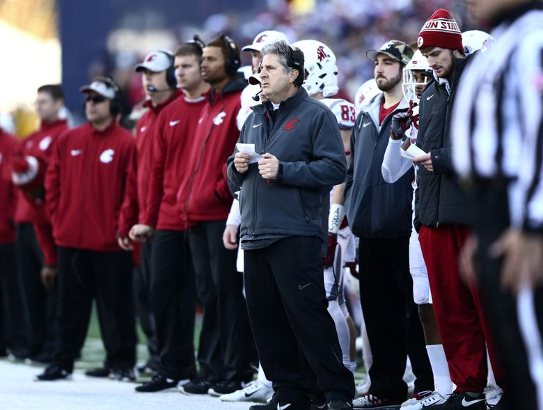 Washington State head coach Mike Leach  watches the game from the sidelines as Washington State quarterback Luke Falk, right, stands by during the 108th Apple Cup at Husky Stadium on Friday, Nov. 27, 2015. Washington beat Washington State 45-10. (Lindsey Wasson / The Seattle Times)