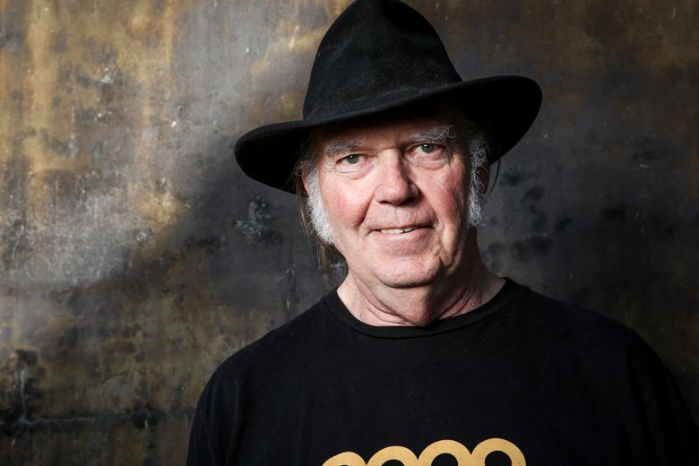 """FILE – In this May 18, 2016 file photo, Neil Young poses for a portrait in Calabasas, Calif.  Young will be Dan Rather's first guest for the new edition of Rather's series, """"The Big Interview."""" Young will be featured on the Sept. 13 episode airing at 8 p.m. EDT on AXS TV. (Photo by Rich Fury/Invision/AP, File)"""