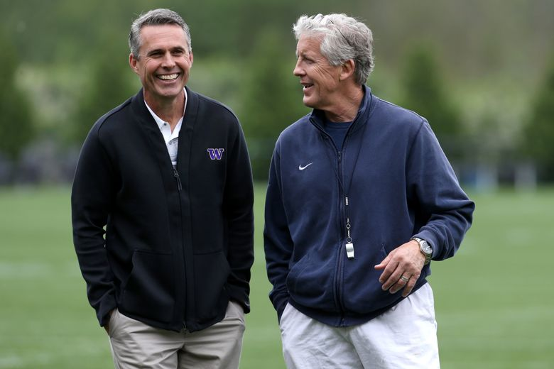 Former UW coach Chris Petersen talks with Seahawks coach Pete Carroll in 2016. (Johnny Andrews/The Seattle Times, file)