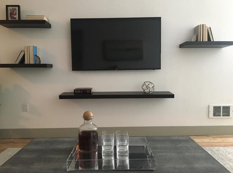 A look at Matt Calkins' TV and shelving at his new apartment. (Matt Calkins / The Seattle Times)