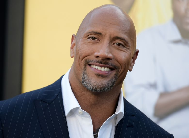 """FILE – In this June 10, 2016 file photo, Dwayne Johnson attends the premiere of his film, """"Central Intelligence""""  in Los Angeles.  Johnson is the highest-paid actor with a fast and furious income of $64.5 million, according to Forbes magazine. Johnson, the former wrestler whose income swelled thanks to the films """"Central Intelligence"""" and """"Fast 8,"""" beat out Jackie Chan with $61 million and Matt Damon, who earned $55 million. (Photo by Richard Shotwell/Invision/AP, File)"""
