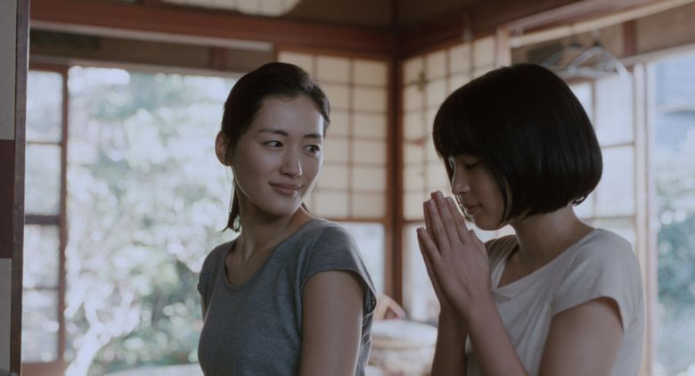 """A teenage girl named Suzu (played by Suzu Hiro, right) bonds with her new family, including oldest stepsister Sachi (Haruka Ayase), in """"Our Little Sister."""""""