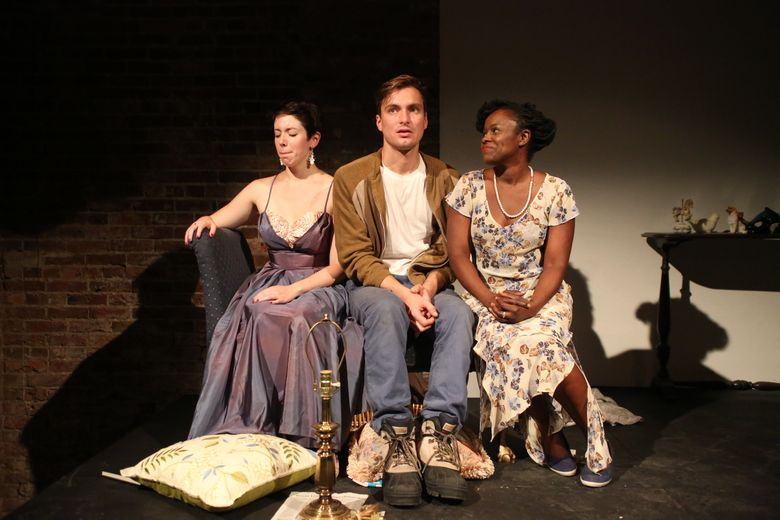 """Elise LeBreton, left, Leicester Landon and Nancy Moricette in """"The Glass Menagerie,"""" an immersive production of Tennessee Williams' classic play by The Williams Project and Cafe Nordo."""