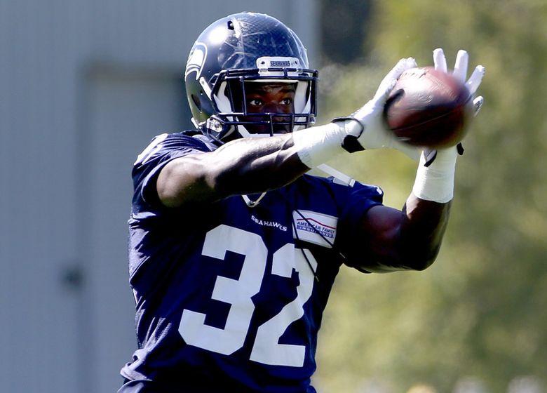 Seattle Seahawks running back Christine Michael catches a pass during training camp at the Virginia Mason Athletic Center on Monday, August 15, 2016, in Renton. (Johnny Andrews/The Seattle Times)