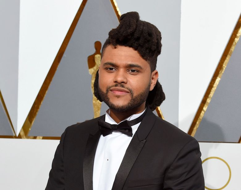 FILE – In this Feb. 28, 2016 file photo, The Weeknd arrives at the Oscars  in Los Angeles. The Weeknd is donating $250,000 to the Black Lives Matter movement. (Photo by Dan Steinberg/Invision/AP, File)
