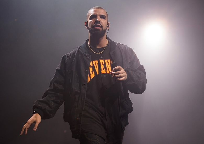 """FILE – In this Aug. 5, 2016 file photo, Drake performs in concert as part of the Summer Sixteen Tour in New York. Drake is dominating at the BET Hip Hop Awards for a third year, garnering the most nominations with 14. BET said Thursday that the """"Hotline Bling"""" rapper is nominated for album of the year, best live performer and other awards, to be presented Sept. 17 in Atlanta. The show will air on BET on Oct. 4. (Photo by Charles Sykes/Invision/AP, File)"""